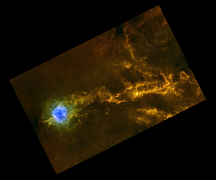 This colour-composite image of IC 5146 shows the extended filamentary structure of this star-forming cloud.